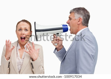 Businessman screaming after his colleague with a megaphone against white background - stock photo