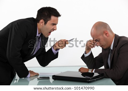 Businessman screaming at a colleague - stock photo