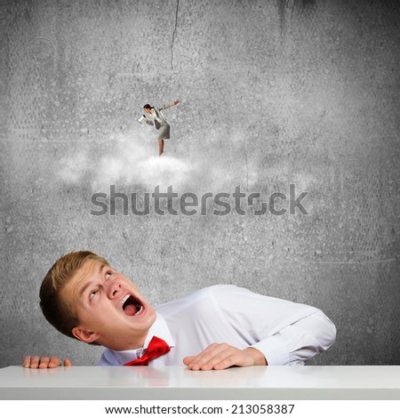 Businessman screaming at businesswoman standing on cloud