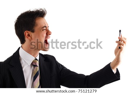 Businessman screaming at the phone. Office in the background. - stock photo