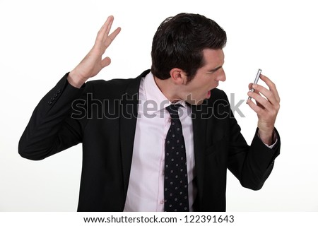 Businessman screaming down the phone
