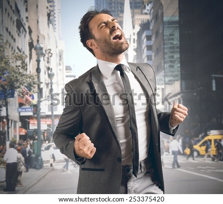 Businessman screaming happy after reaching a goal - stock photo