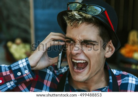 businessman screaming on the mobile phone
