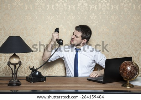 businessman screaming to the handset - stock photo