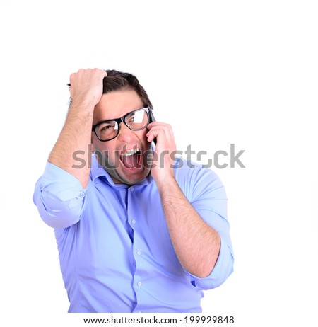 Businessman screaming while having conversation on cell phone - stock photo