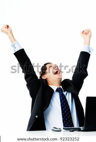 Businessman sealing his first deal and raises both arms in the air