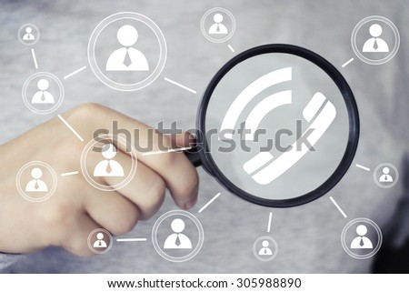 Businessman search loupe magnifier telephone icon - stock photo