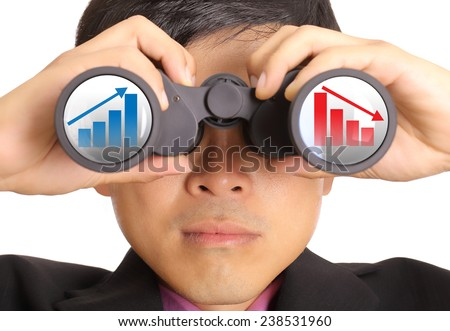 Businessman search stock through binoculars for check and predict trend marketing