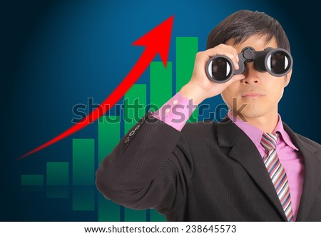 Businessman search stock through binoculars for check and predist trend marketing