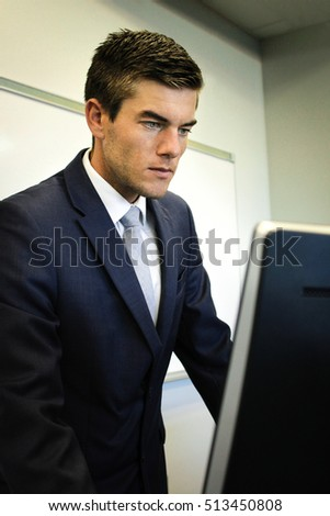 Businessman searching on computer