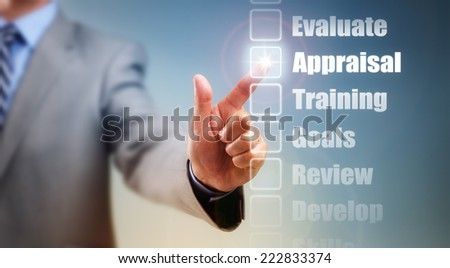 Businessman selecting self improvement options for appraisal, goals and training - stock photo