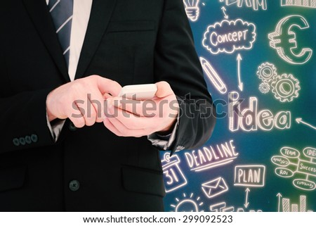 Businessman sending a text message against blue background