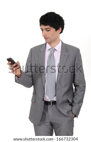 Businessman sending message from phone - stock photo
