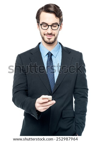 Businessman sending message in his mobile phone - stock photo