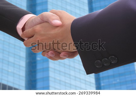 Businessman shake hands for deal thier business. - stock photo