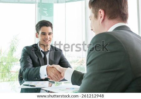 Businessman shaking hand, business situation - stock photo