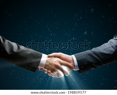 Businessman shaking hand to partner with succesful deal
