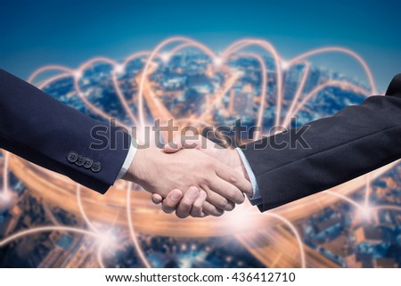 Businessman shaking hand with technology connection background - stock photo