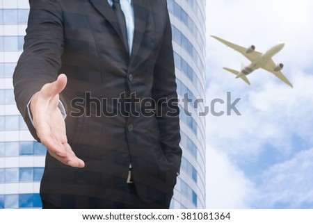 businessman shaking hands and office building and a plane,double exposure,business concept - stock photo