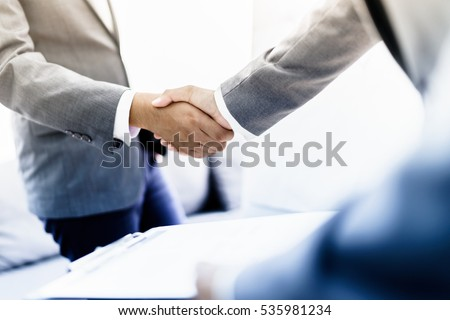 businessman shaking hands to seal a deal with his partner