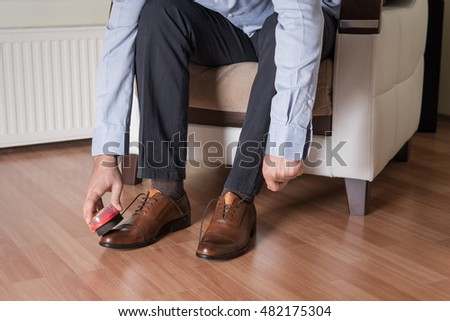 Businessman shining the shoes