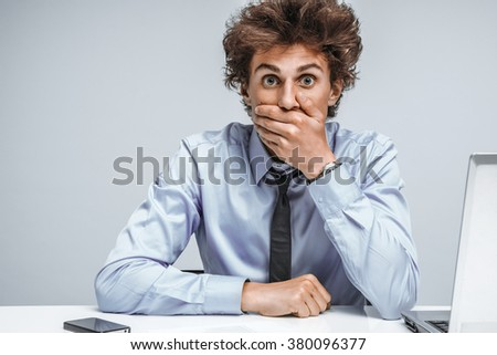 Businessman shocked what happened, looking at camera / modern office man at working place, depression and crisis concept