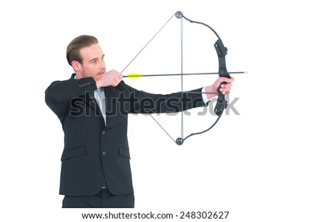 Businessman shooting a bow and arrow on white background