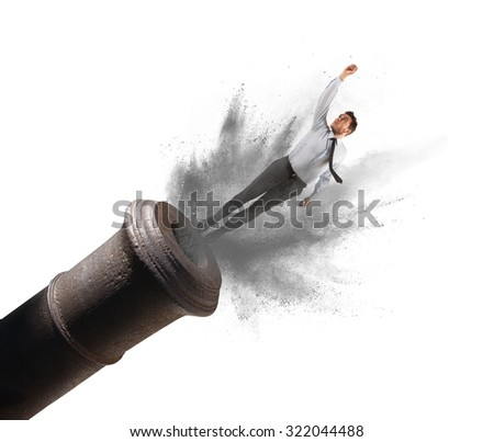 Businessman shot from a cannon with power - stock photo