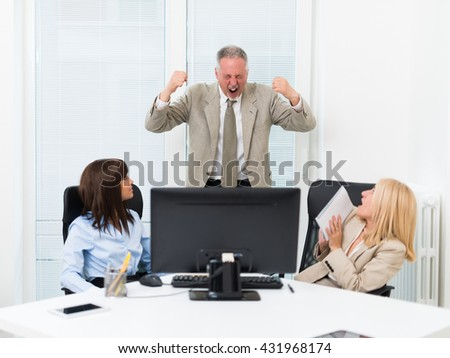 Businessman shouting at his employees - stock photo