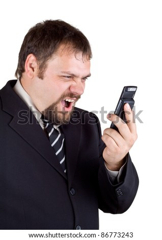 Businessman shouting into a mobile phone, isolated on white background