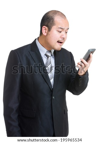 Businessman shouting on mobile