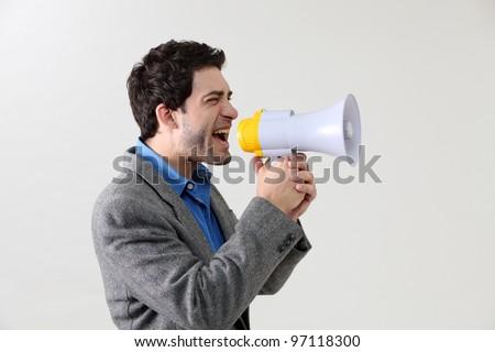 Businessman shouting through megaphone - stock photo