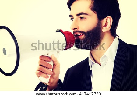 Businessman shouting using a megaphone. - stock photo