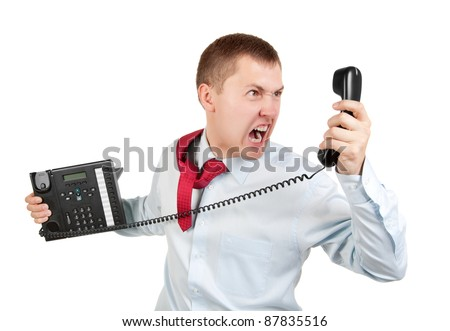 Businessman shouts on the phone on white background - stock photo