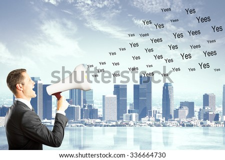 Businessman shouts yes on the city background, say yes concept