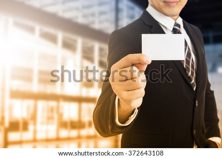 Businessman show business card for introduce himself. - stock photo