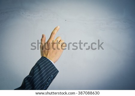 Businessman show hand up good idea concept - stock photo