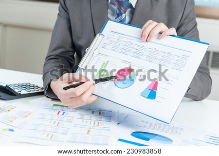 Businessman show report, business performance concept - stock photo