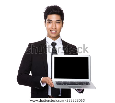 Businessman show with blank screen of computer