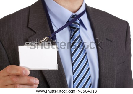 Businessman showing a blank identity name card - stock photo