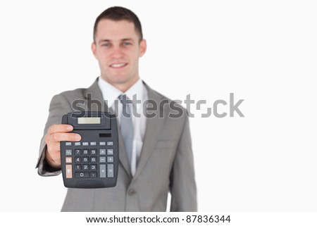 Businessman showing a calculator against a white background