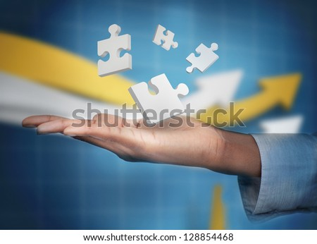 businessman showing a handshake to the camera - stock photo