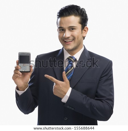 Businessman showing a mobile phone - stock photo
