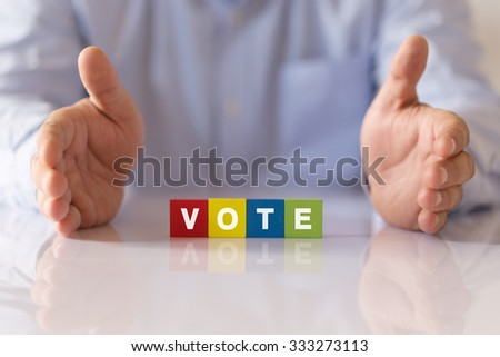 Businessman Showing a word VOTE