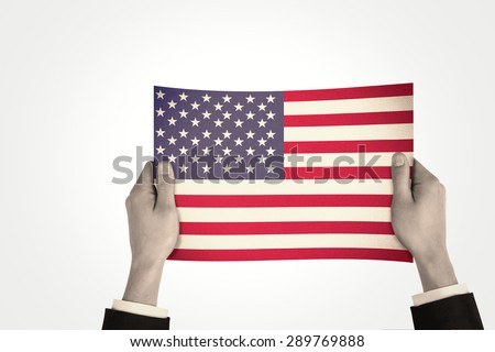 Businessman showing against usa national flag
