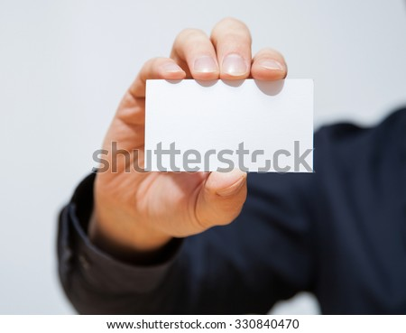 Businessman showing an empty business card, closeup shot