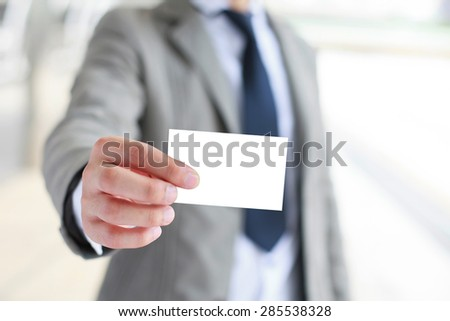 Businessman showing business card. - stock photo