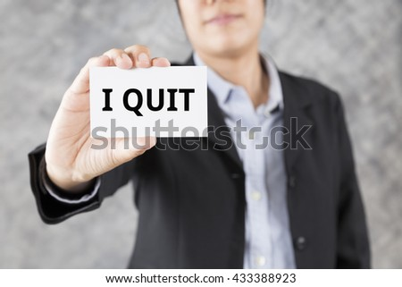businessman showing business card with word I quit