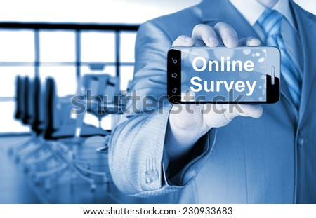 Businessman showing business concept on smartphone  - Online Survey