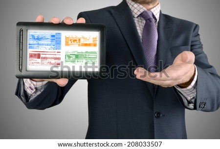 Businessman showing business concept on tablet